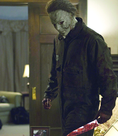 michael myers nick castle with knife in hand begins to murder naive