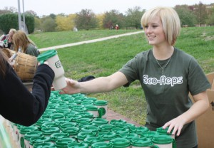 Freshman Katelyn White hands out Broncs Go Green mugs to students to encourage a more sustainable lifestyle.