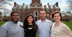 From left, junior Emmanuel Acosta, treasurer; junior Noreen Goldberg, president; senior Edgar Mariano, vice president; and sophomore Kayla McLaughlin, secretary, pose in front of Williamson Hall after winning the Student Government Association election.