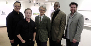 "From left, artists Wendel A. White and Joshua Lutz, professor and gallery director Harry Naar, guest curator for exhibition Aubrey Kaufman, and artists Josh Brilliant, and artist Annie Hogan, not pictured, are all part of  ""Landscape: Social, Political, Traditional."" The exhibit will be on display in the Rider art gallery until Oct. 12."