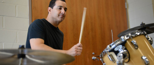 After working with artists such as Lady Gaga and Bruce Springsteen, Rich Scannella, who teaches classes like MUS 127: Arts Administration Ensemble and MUS 167B: Applied Percussion at Rider, was given the opportunity to go on the road with Bon Jovi as the band's fill-in drummer in locations around the world including Canada, Rio de Janeiro and Osaka, Japan .