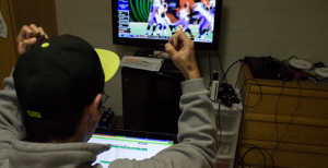 Sophomore Cory Andrews celebrates good news for his fantasy football team from the comfort of his dorm room.