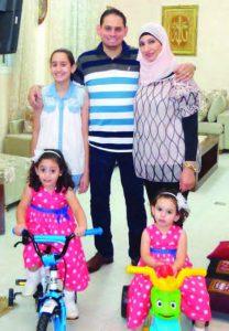 Abdullah Erakat stands between his daughter Haya, 11, and his wife, Noura. The younger daughters are Mira, 3, and Laura, 2.