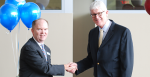 From left, Jamie O'Hara, Rider vice president of enrollment management, and Dr. Clayton Railey III, provost of Bucks County Community College, shake hands after the agreement of partnership between the two schools for transfer opportunities.