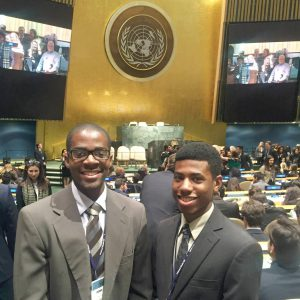Aasim Johnson, left, and Stanley Clark stand at the UN general assembly for the awards ceremony in New York City.