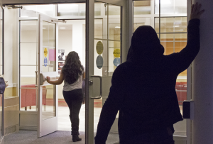 Two recent intrusions occurred when an unidentified man was granted access into West Village B. The handicapped-accessible doors take 13 seconds to close. This photographic re-enactment was created to represent the ease of following someone into a locked campus building.