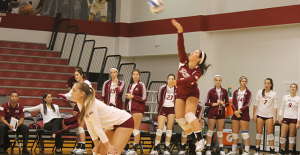 Sophomore defensive specialist Emma Aldaya goes up for a serve in a win against Siena on Sept. 27.