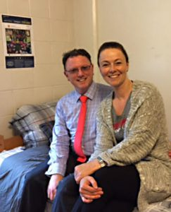 Westminster Dean Matthew Shaftel and his wife, Pascale, sit on a bed in Ithica hall before the dean stayed over for the night.
