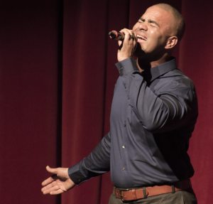 Broadway actor Christopher Jackson singing during his Q&A and performance for the Rider community on Monday.