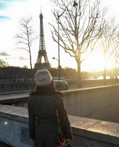 Nicole Alvarico sits in front of the Louvre (left), where she spent a lot of her free time, and looks at the Eiffel Tower.
