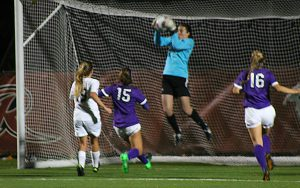 Junior goalkeeper Bethany May-Howard jumps up for her only save of the game; Rider won 4-1.