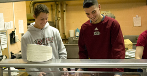 Jake Bender (left) and Nick Payesko, from the baseball team, help serve over 400 Thanksgiving-style lunches to those afflicted by poverty in Trenton on Nov. 21  at the Saint Mary of the Assumption Cathedral. Over 70 Rider students volunteered for the event.