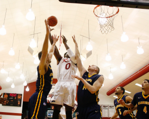 Junior center Kahlil Thomas goes up for a lay-up to tie the game at 2 against Canisius at Alumni Gym