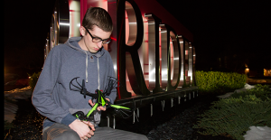 Junior information systems major Nicholas McManus holds his drone outside campus after the administration placed a ban on hoverboards and restrictions on drones because of safety hazards.  Since December, more than 30 colleges and universities have done the same.