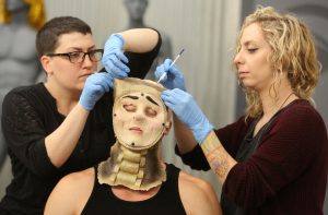 "Melanie Licata (left) and Ana Cali sculpt their Watch Man for the ""Child's Play"" challenge on Face Off."