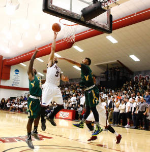 Guard Teddy Okereafor lays one in against Siena on Feb. 19.