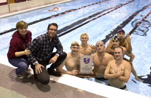 Head Coach Stephen Fletcher, Assistant Coach Shannon Daly and some of the men from their championship team on Feb. 13.