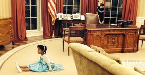 Dressed as Elsa, Lorjuste's daughter, 5-year-old Riley Elizabeth, sits on the Oval Office rug.