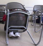 Students hide under desks and chairs during an active shooter response exercise in North Hall on March 22.