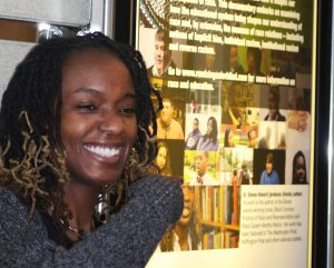 Sheena Howard, standing in front of a theater showing her documentary, Remixing Colorblind. The film discusses issues of race and diversity on college campuses.
