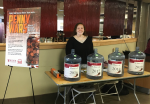 Senior Tara Roach stands guard over each grade level's pennies in Daly Dining Hall on March 23.