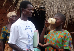 Community distributors administer Mectizan to individuals in 392 African villages in June 2007.