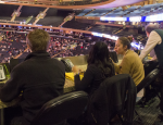 Daniel Kingsley, Daniela Merino and Isabella Cadavid sat in the press box at Madison Square Garden during the National Invitation Tournament final on March 31. Nine students from Professor Chuck Bausman's sports reporting class attended the event.