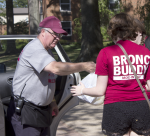 Dean of Students Anthony Campbell helps Bronc Buddies unload freshmen vehicles during move-in day on Sept. 6, 2015.