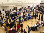 Students browse the booths of potential employers at the annual fall career fair.