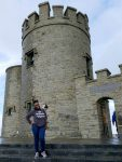 Senior public relations major Modjina Ovil stands in front of O'Brien's Tower in County Clare, Ireland. She is spending her fall semester studying abroad and interning at Alice PR & Events.
