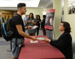 "Author Sonia Nazario signs books after her keynote lecture on her Pulitzer Prize-winning novel ""Enrique's Journey."""