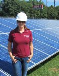 Sustainability manager Melissa Greenberg participates in a solar project at Rider.