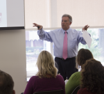 President Gregory Dell'Omo addresses a classroom of over 100 students and faculty on Oct. 13.