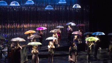 Photo of Performers laugh, sing and shine in 'the Rain'