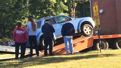 Photo of Female student drives onto trailer near Fine Arts circle