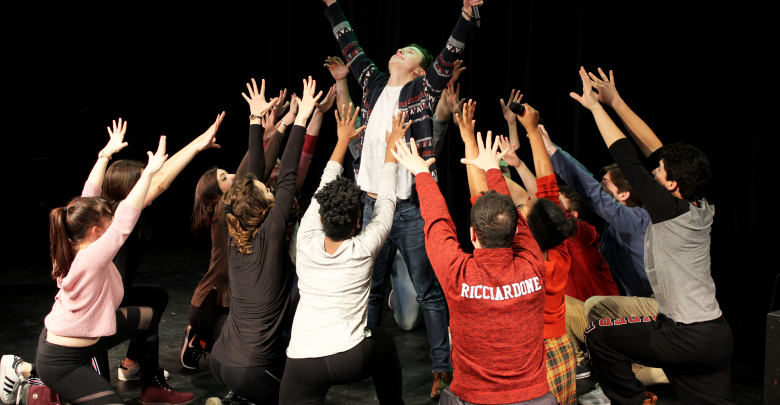 Photo of Performers present an empowering message with the theme of perseverance