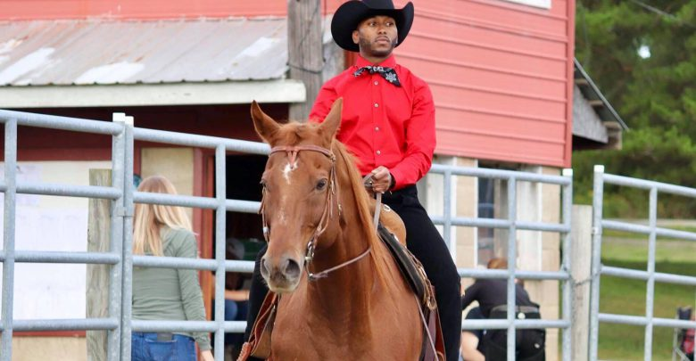 Photo of Rider's cowboy gallops onward toward his fifth degree
