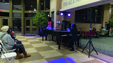 "Photo of Dueling Pianos has no ""treble"" drawing a crowd"